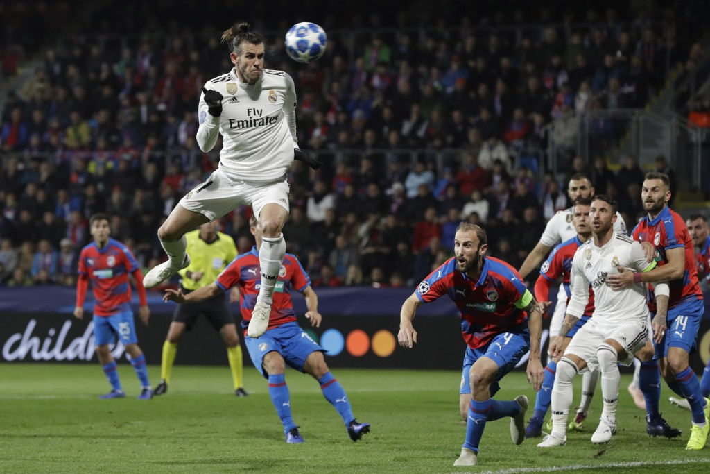Real midfielder Gareth Bale heads the ball at the goal during their Champions League group G soccer match between Real Madrid and Viktoria Plzen at th