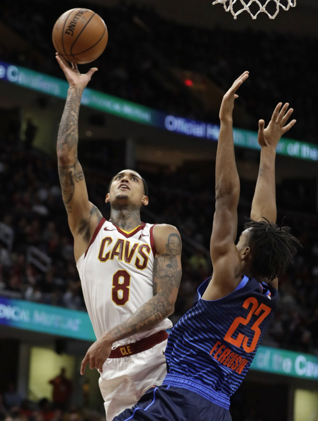 Cleveland Cavaliers' Jordan Clarkson (8) shoots over Oklahoma City Thunder's Terrance Ferguson (23) during the first half of an NBA basketball game We