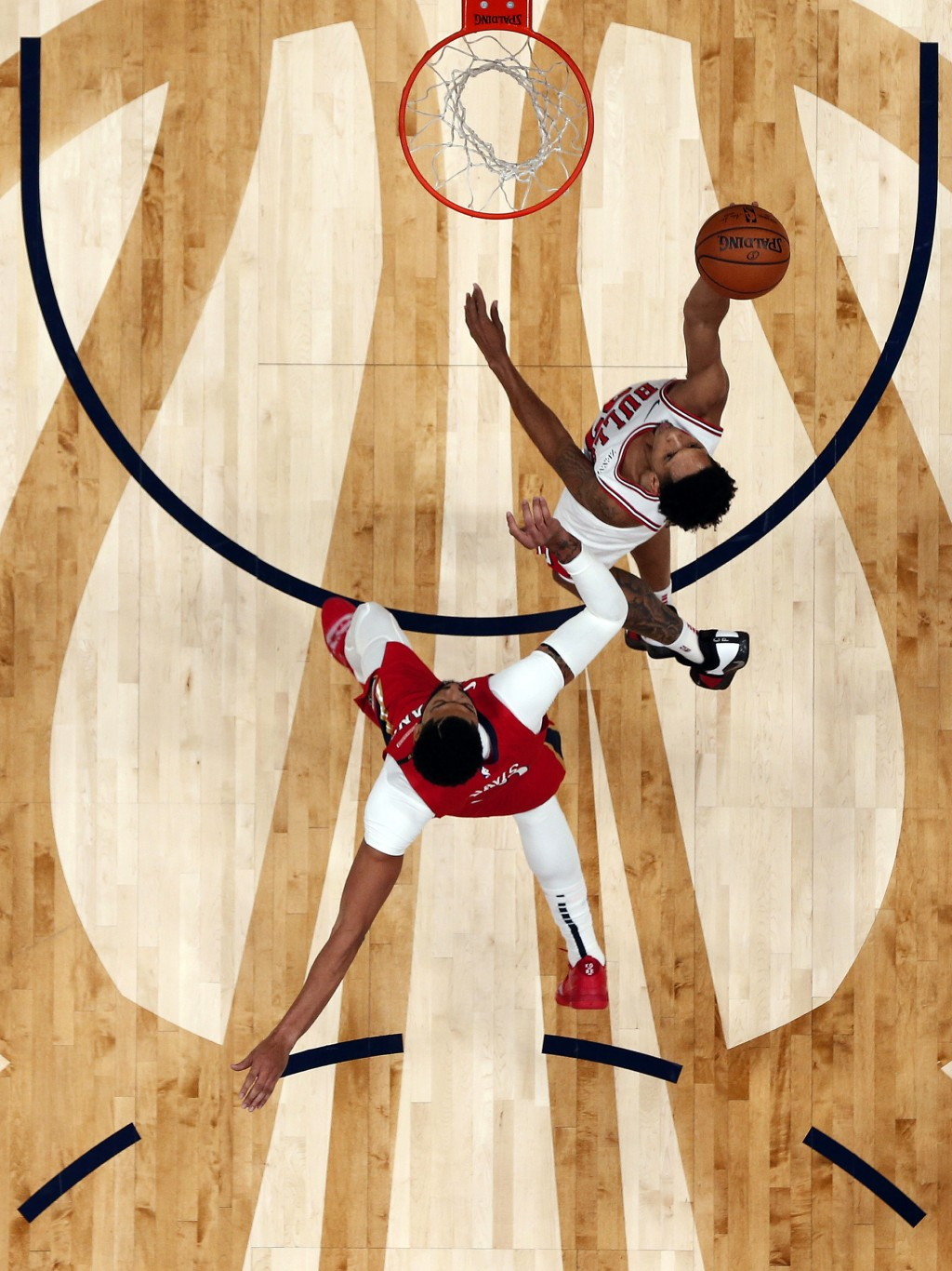 Chicago Bulls guard Cameron Payne goes to the basket against New Orleans Pelicans forward Anthony Davis during the first half of an NBA basketball gam