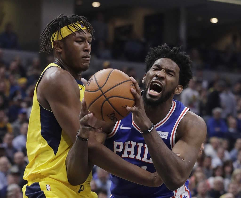 Philadelphia 76ers' Joel Embiid is fouled by Indiana Pacers' Myles Turner during the first half of an NBA basketball game, Wednesday, Nov. 7, 2018, in