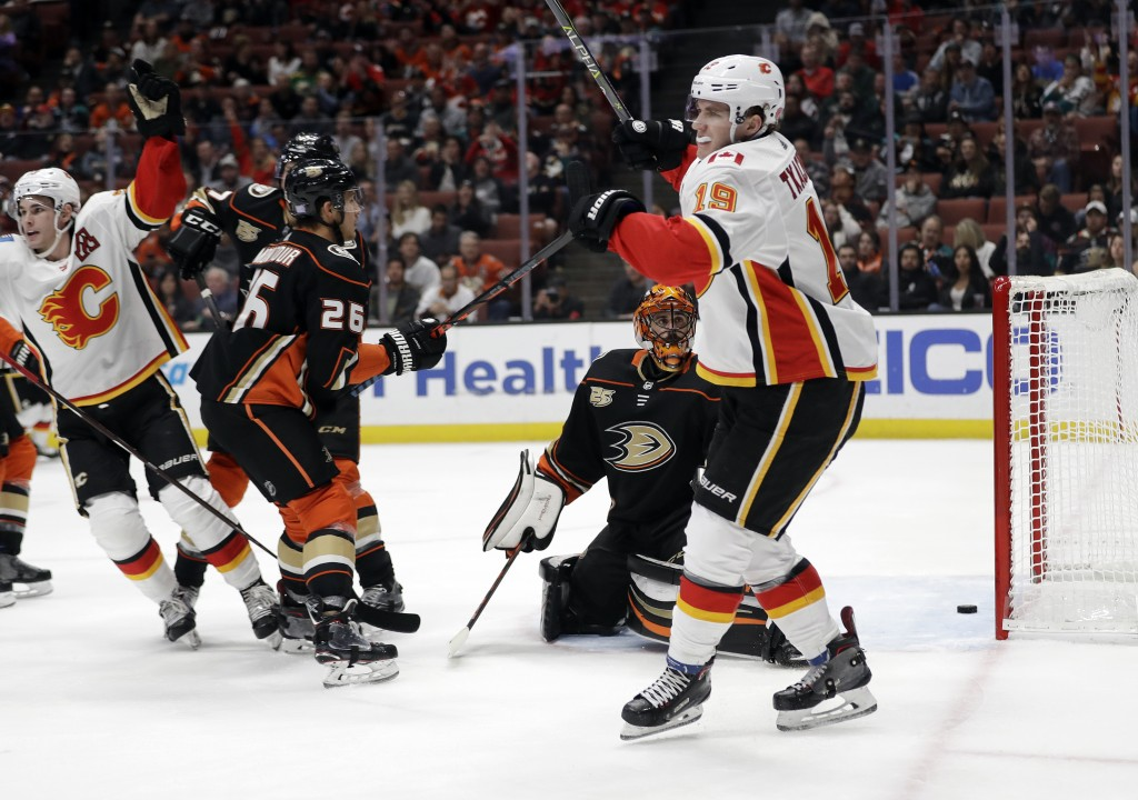Calgary Flames' Matthew Tkachuk, right, celebrates his goal against the Anaheim Ducks during the first period of an NHL hockey game Wednesday, Nov. 7,