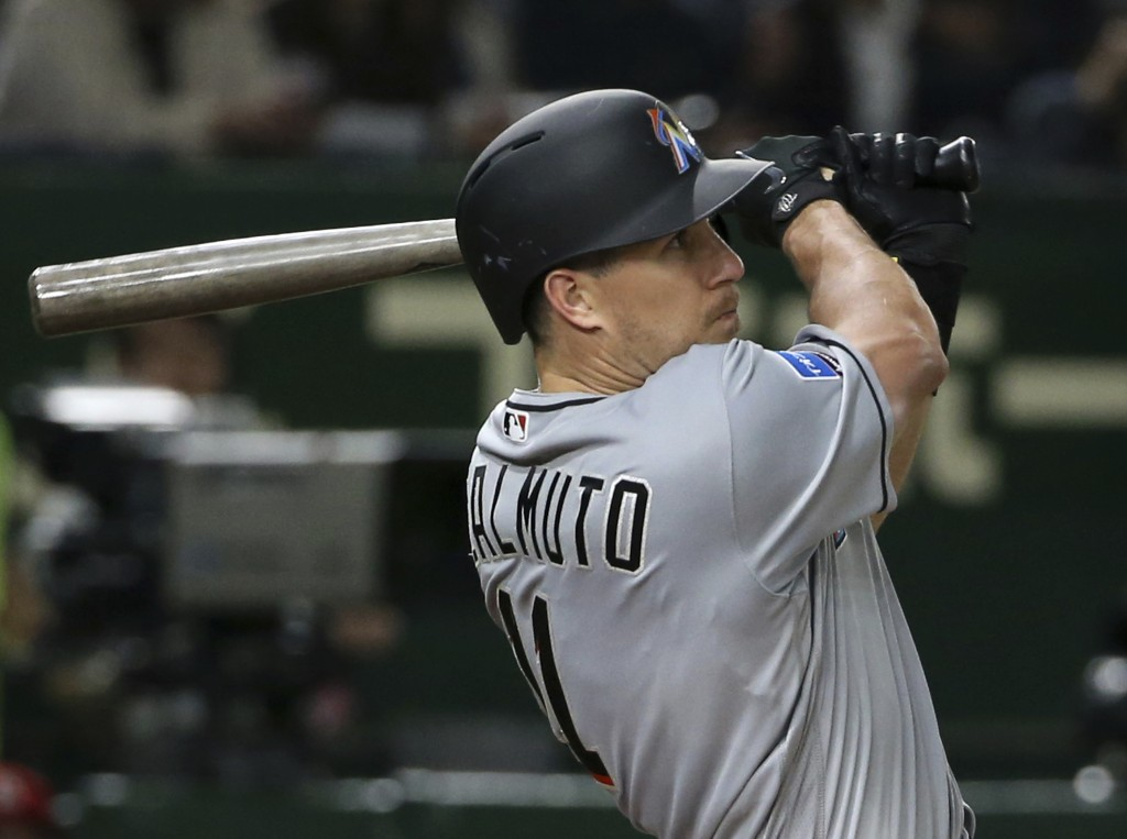 MLB All-Star catcher J.T. Realmuto of the Miami Marlins hits a solo home-run off Yomiuri Giants pitcher Ryusei Oe in the fifth inning of their exhibit