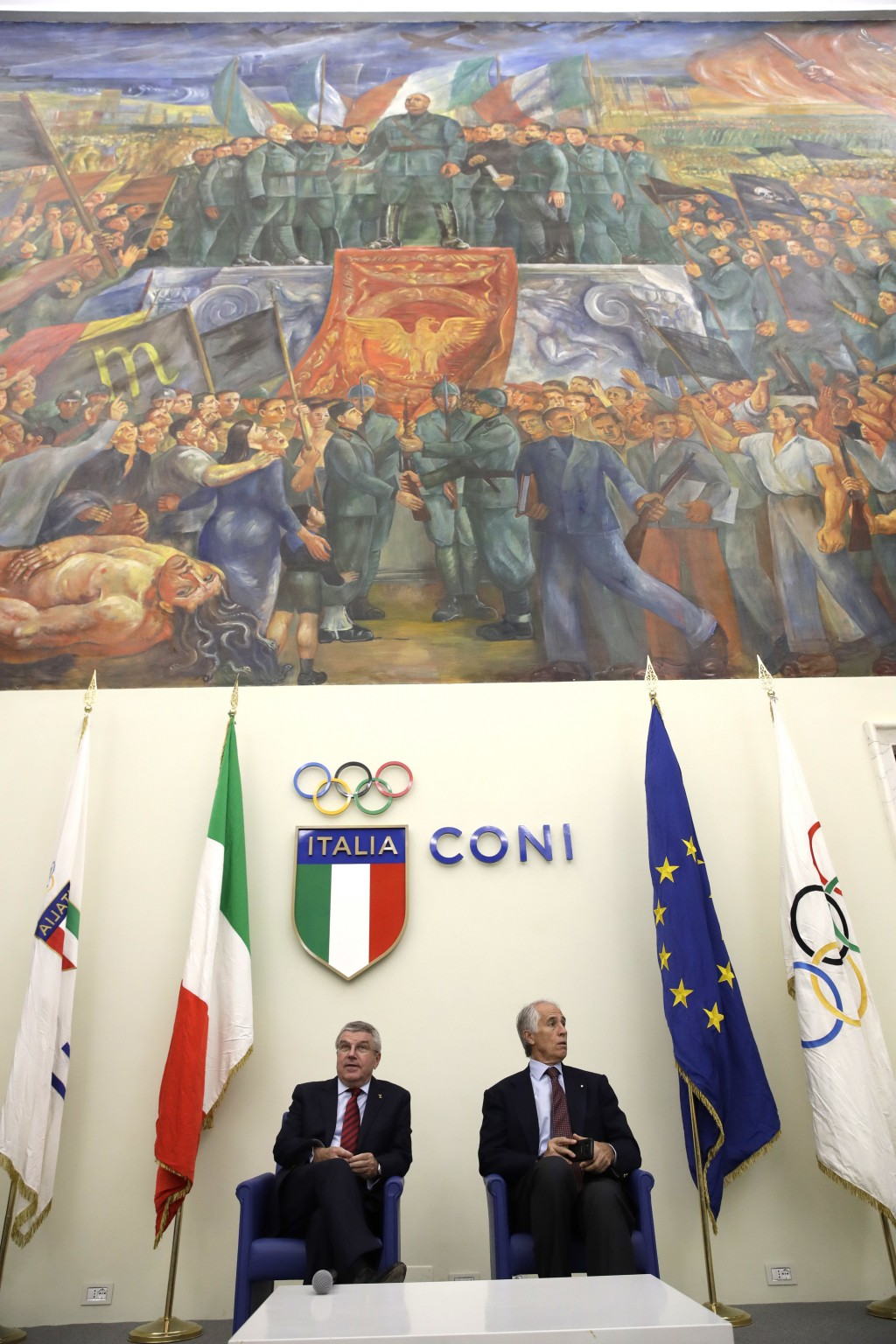 International Olympic Committee President Thomas Bach, left, and Italian Olympic Committee President Giovanni Malago', attend a press conference, in R