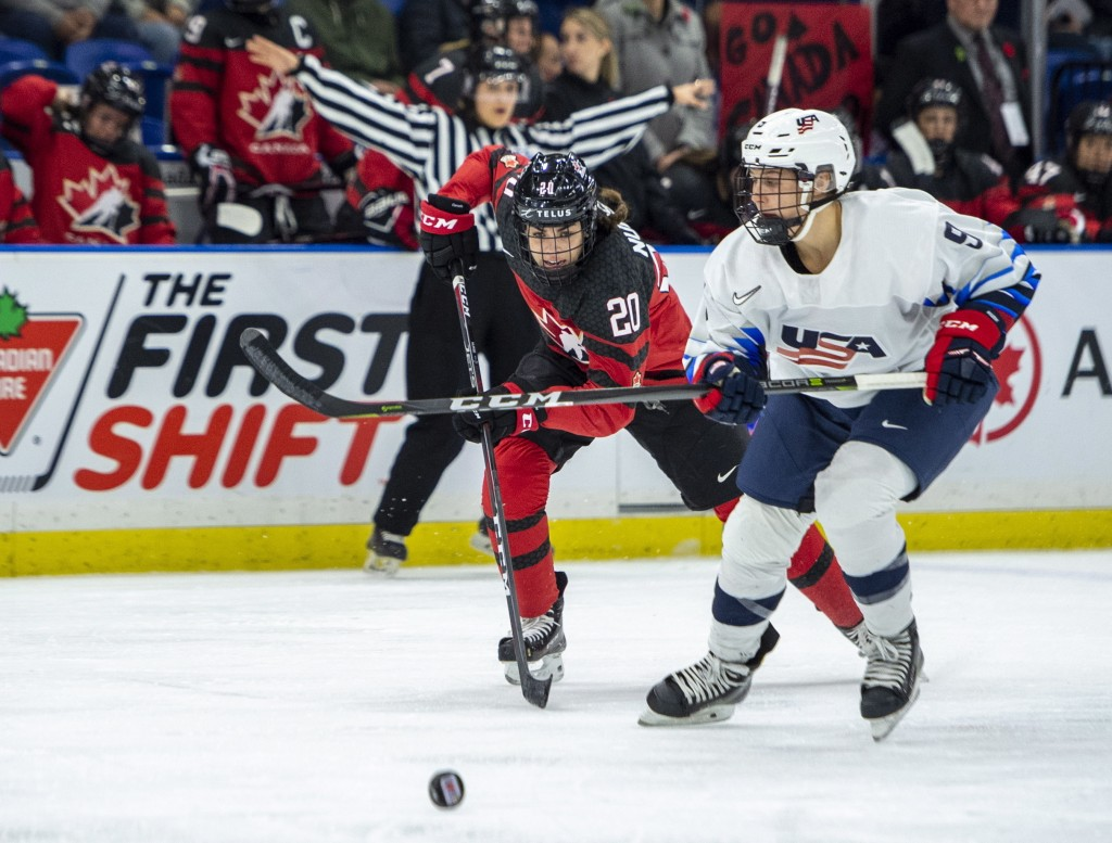 Canada forward Sarah Nurse races for the puck next to U.S. defenseman Megan Bozek during the second period of a Four Nations Cup hockey preliminary ga