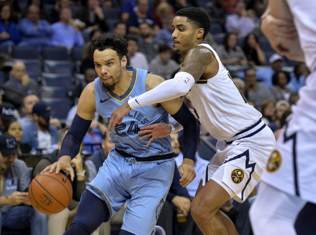 Memphis Grizzlies guard Dillon Brooks (24) drives against Denver Nuggets guard Gary Harris in the second half of an NBA basketball game Wednesday, Nov...