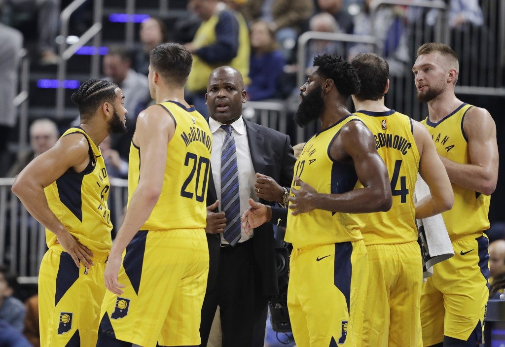 Indiana Pacers head coach Nate McMillan talks to his team during the first half of an NBA basketball game against the Philadelphia 76ers, Wednesday, N