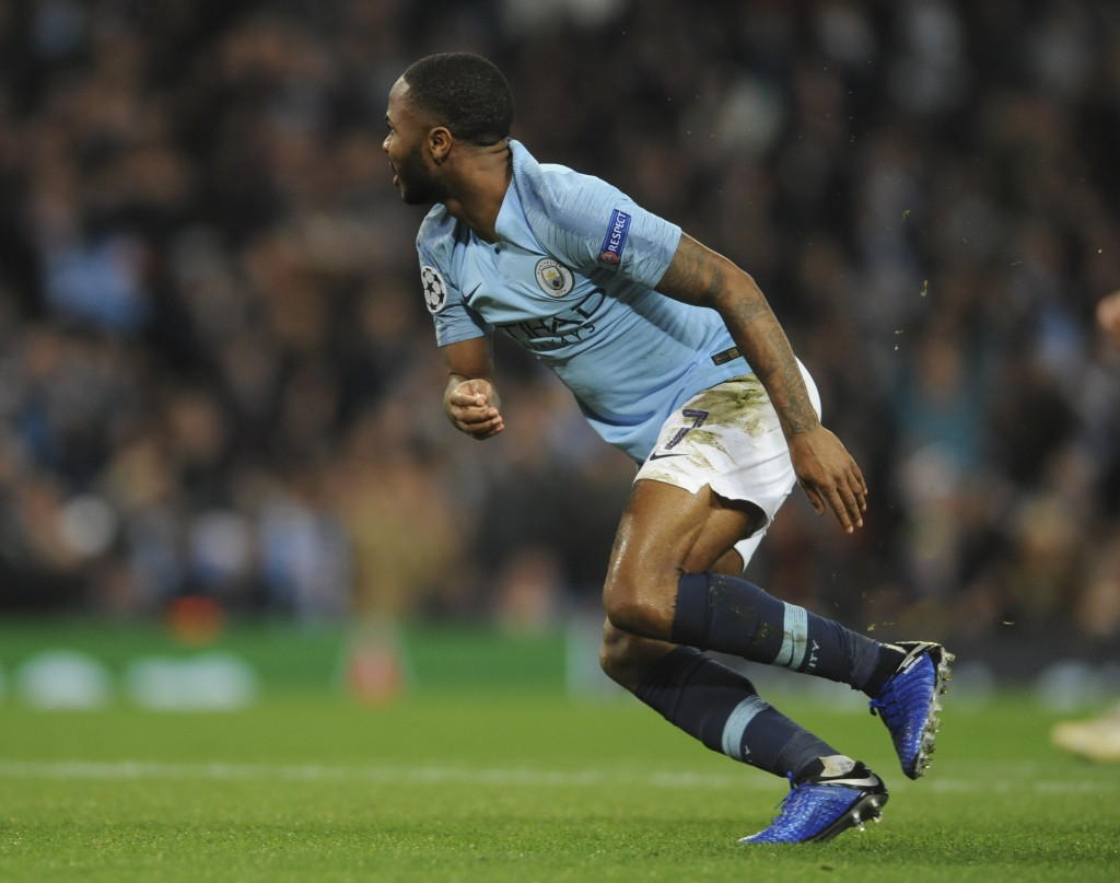 Manchester City midfielder Raheem Sterling celebrates after scoring his side's third goal during the Champions League Group F soccer match between Man