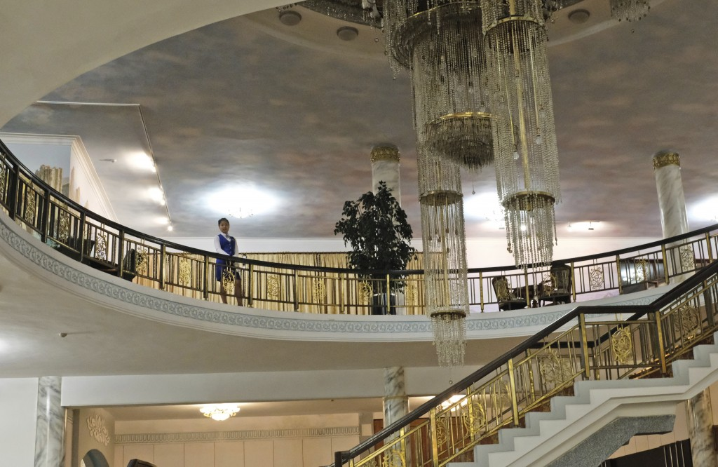 In this Oct. 23, 2018, photo, a hotel staff member stands near a crystal chandelier hanging from the ceiling at the foyer of Kumgangsan Hotel at Mount