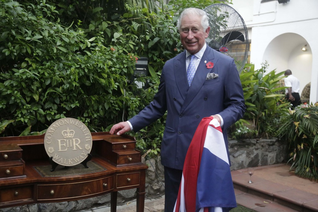 Britain's Prince Charles, stands by a Commonwealth Walkway plaque during a reception at the British deputy High Commissioner in Lagos, Nigeria, Wednes...
