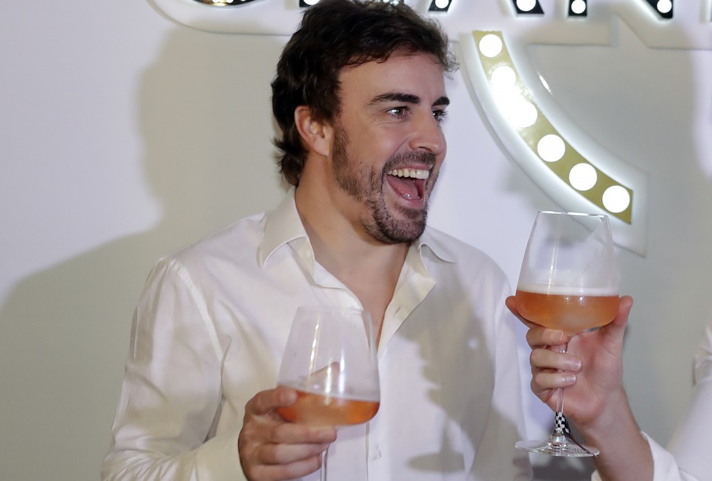 McLaren driver Fernando Alonso, of Spain, makes a toast during a promotion event made by one of his sponsors, in Sao Paulo, Brazil, Wednesday, Nov. 7,...