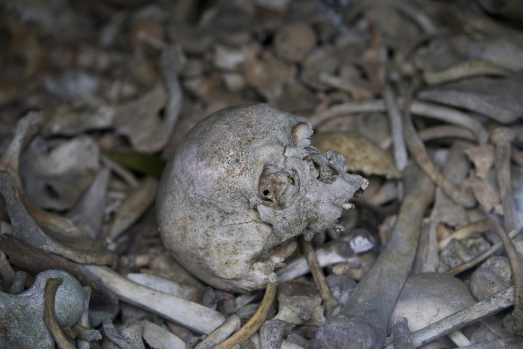 FILE In this file photo taken on April 3, 2017, the bones of soldiers are piled in a crypt at the Douaumont Ossuary in Verdun, France. Hundreds of tro...