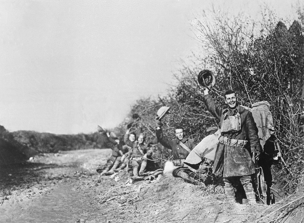 FILE  - In this undated file photo American World War I soldiers wave their helmets after the Nov. 11, 1918 Armistice was signed in France. Hundreds o...