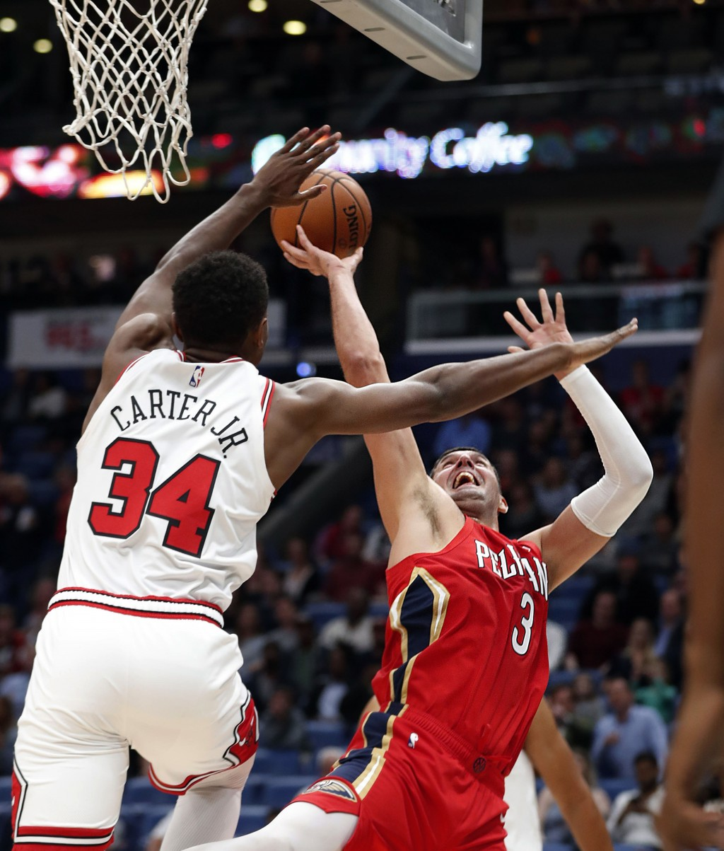 New Orleans Pelicans forward Nikola Mirotic (3) shoots against Chicago Bulls forward Wendell Carter Jr. (34) during the first half of an NBA basketbal...