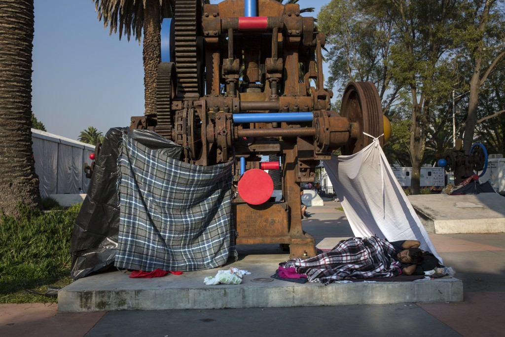 Juan Antonio Ortiz, 38, from Guatemala, rests in a makeshift shelter at the Jesus Martinez stadium in Mexico City, Wednesday, Nov. 7, 2018. Central Am
