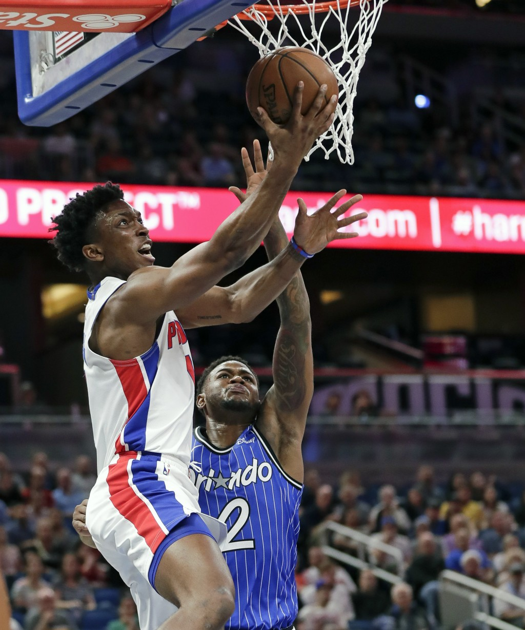 Detroit Pistons' Stanley Johnson, left, goes up for a shot past Orlando Magic's Jarell Martin (2) during the first half of an NBA basketball game, Wed...