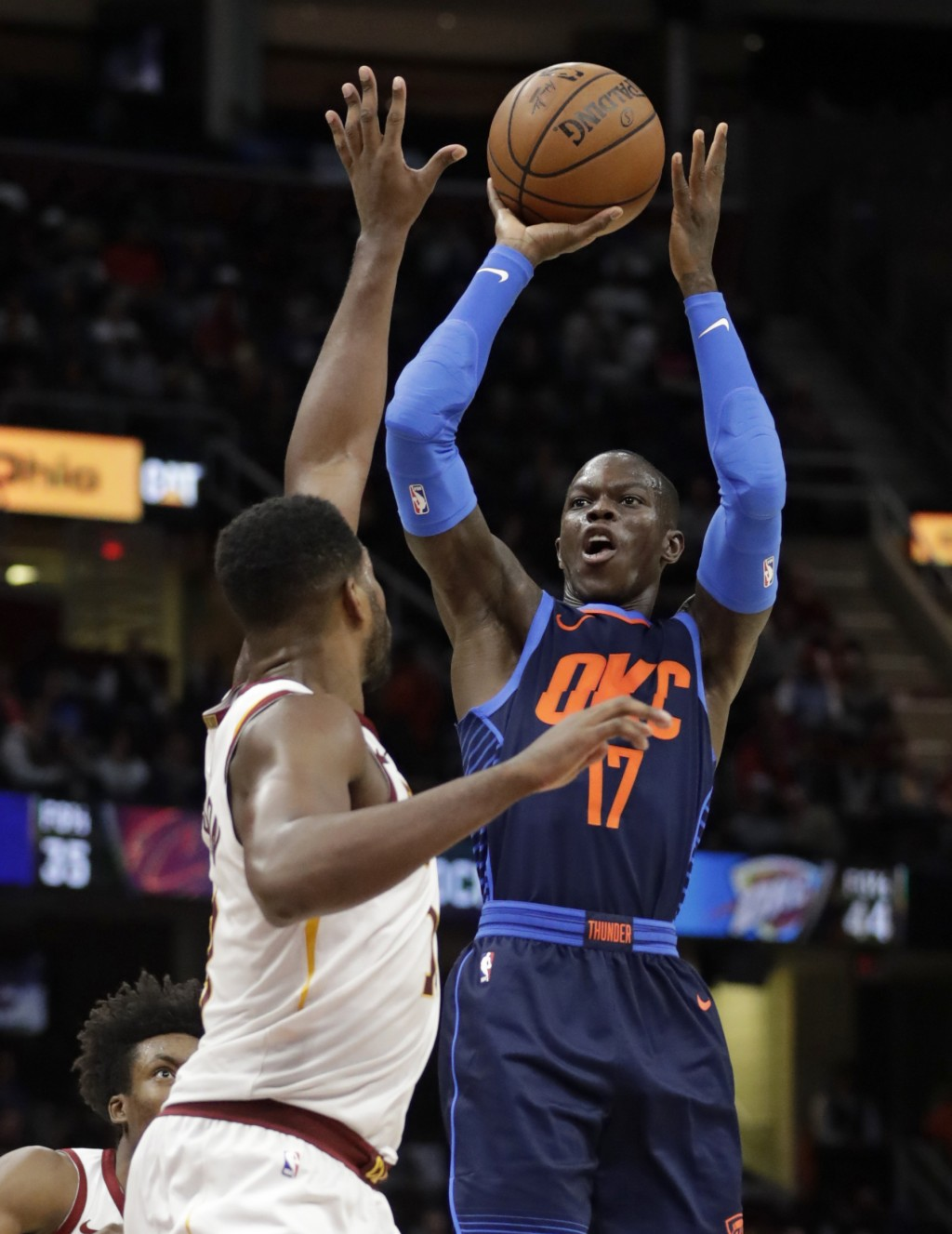 Oklahoma City Thunder's Dennis Schroeder, right, shoots over Cleveland Cavaliers' Tristan Thompson during the second half of an NBA basketball game We