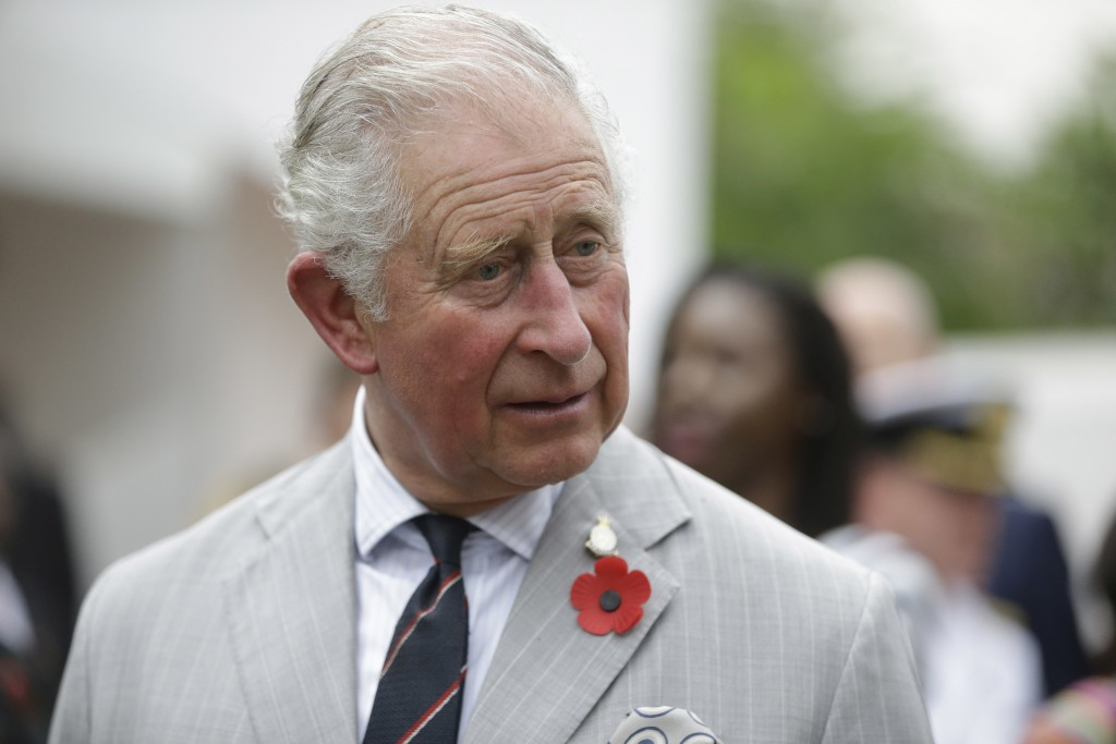 Britain's Prince Charles, centre, speaks to fashion designers during a visit to the British Council Arts Festival in Lagos, Nigeria, Wednesday Nov. 7,...