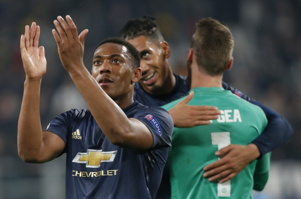 ManU's Anthony Martial celebrates at the end of the Champions League group H soccer match between Juventus and Manchester United at the Allianz stadiu...