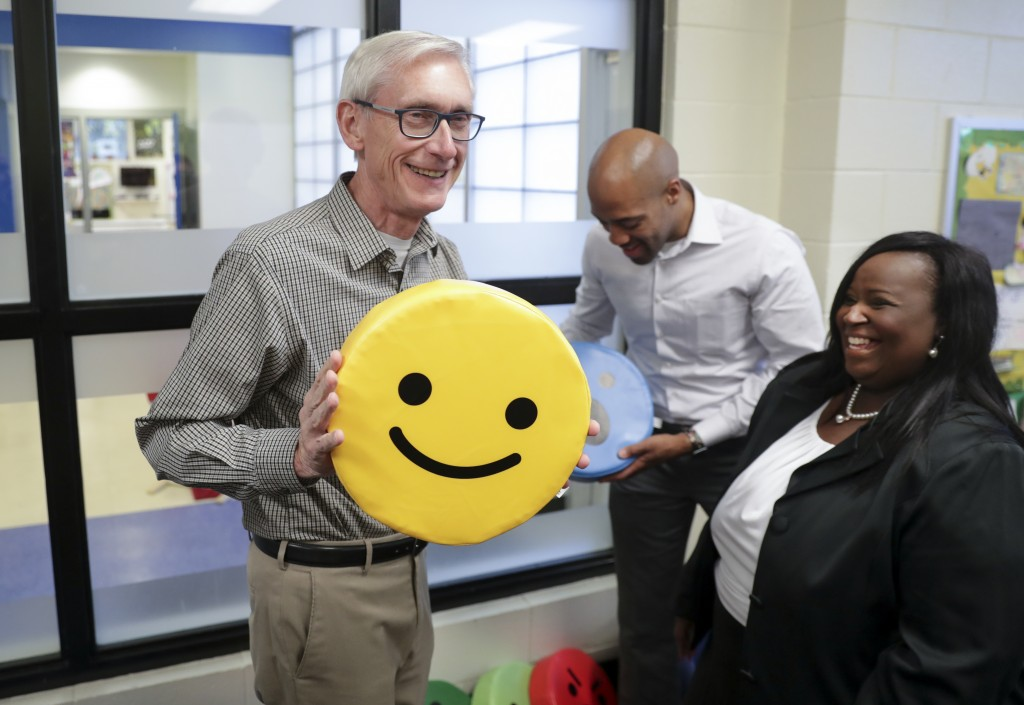 Governor-elect Tony Evers, left, and Lt. Governor-elect Mandela Barnes, right, with pillows found on the tour of the Boys & Girls Club of Dane County....