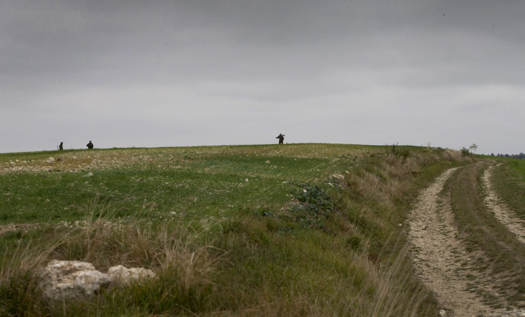 In this photo taken on Monday, Oct. 29, 2018, hunters walk on a hill where American World War I soldier Henry Gunther died in Chaumont-devant-Damville...