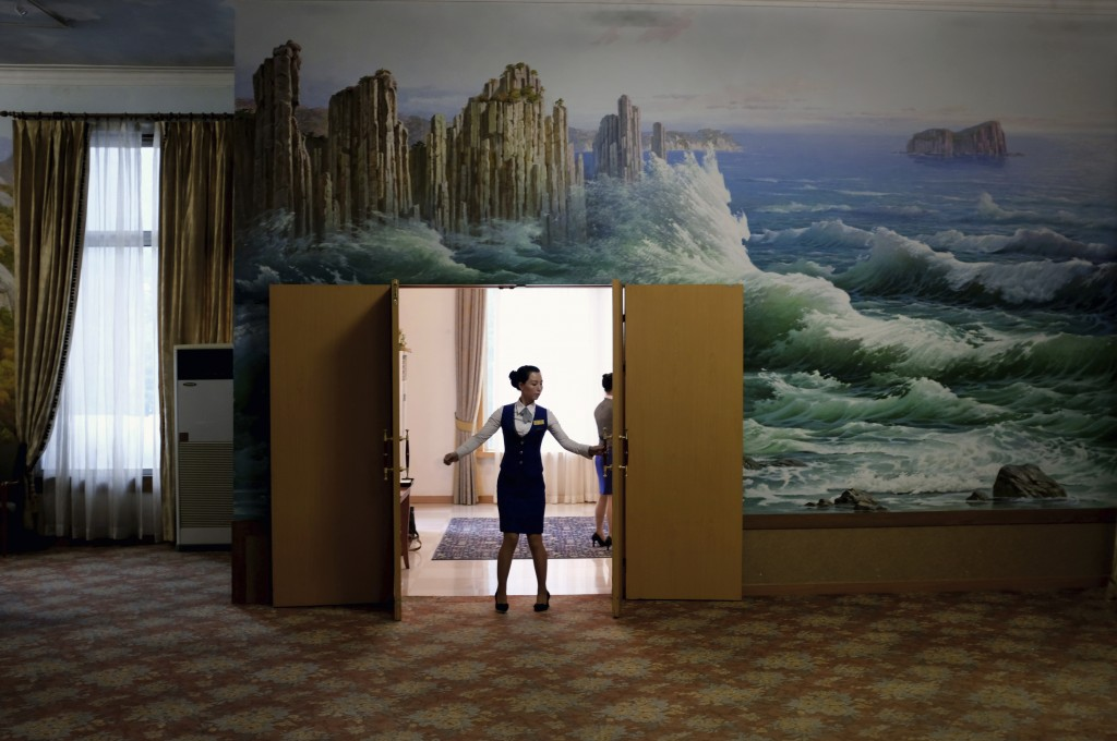 In this Tuesday, Oct. 23, 2018, photo, a staff member closes the doors of a meeting room at the Kumgangsan Hotel at the Mount Kumgang resort area whic