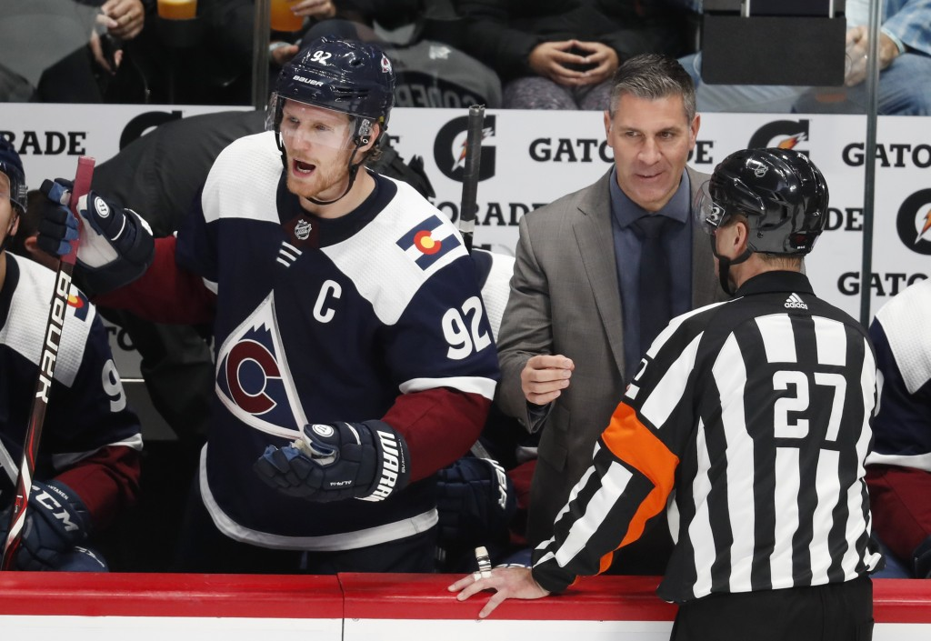 Colorado Avalanche left wing Gabriel Landeskog, left, yells at officials as coach Jared Bednar confers with official Eric Furlatt after an Avalanche g