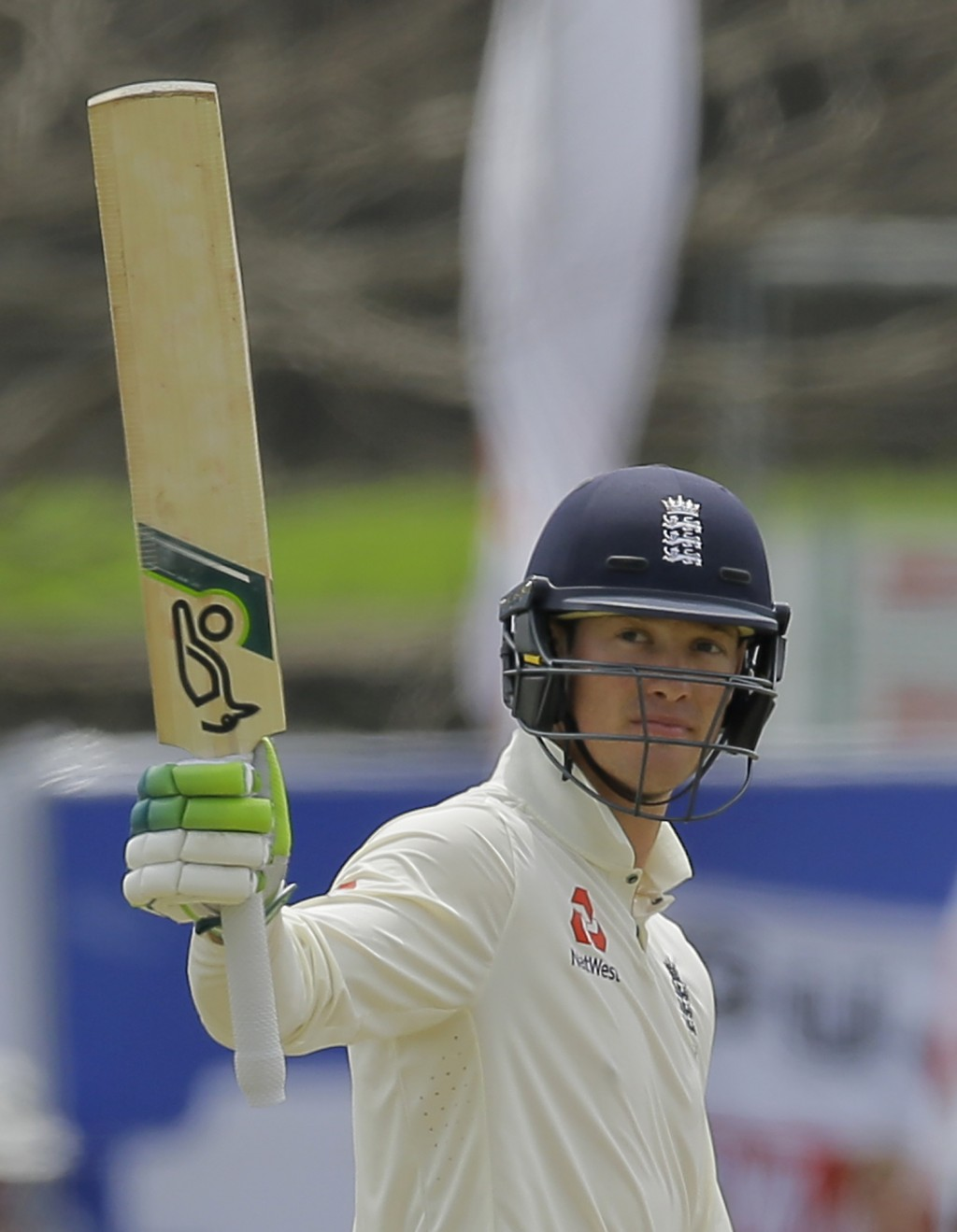 England's Keaton Jennings celebrates scoring a half century during the third day of the first test cricket match between Sri Lanka and England in Gall...