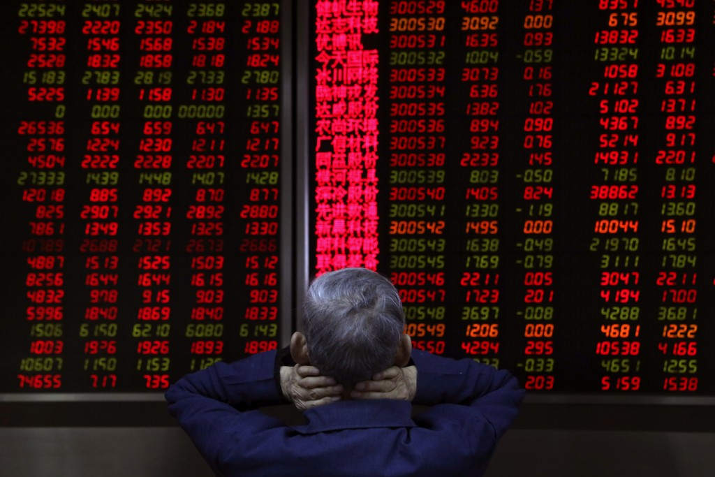 A man monitors stock prices at a brokerage in Beijing, China, Thursday, Nov. 8, 2018. Asian markets rose on Thursday after the U.S. midterm elections