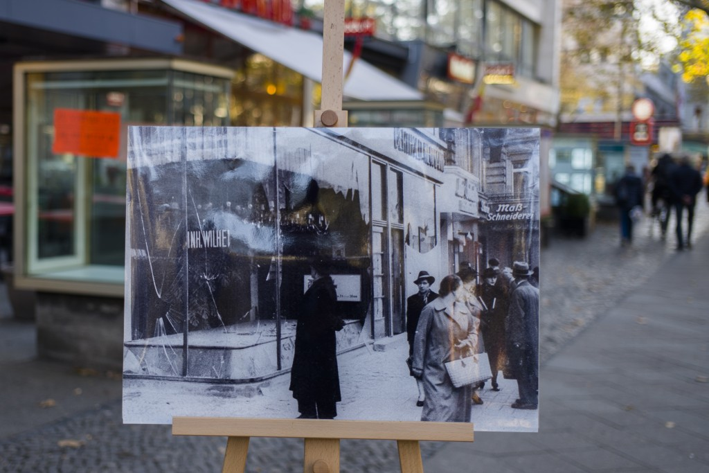 In this Tuesday, Nov. 6, 2018 photo a Nov. 10, 1938 photo from the AP Archive, showing by Nazis destroyed Jewish shops at the Kurfuerstendamm street, ...