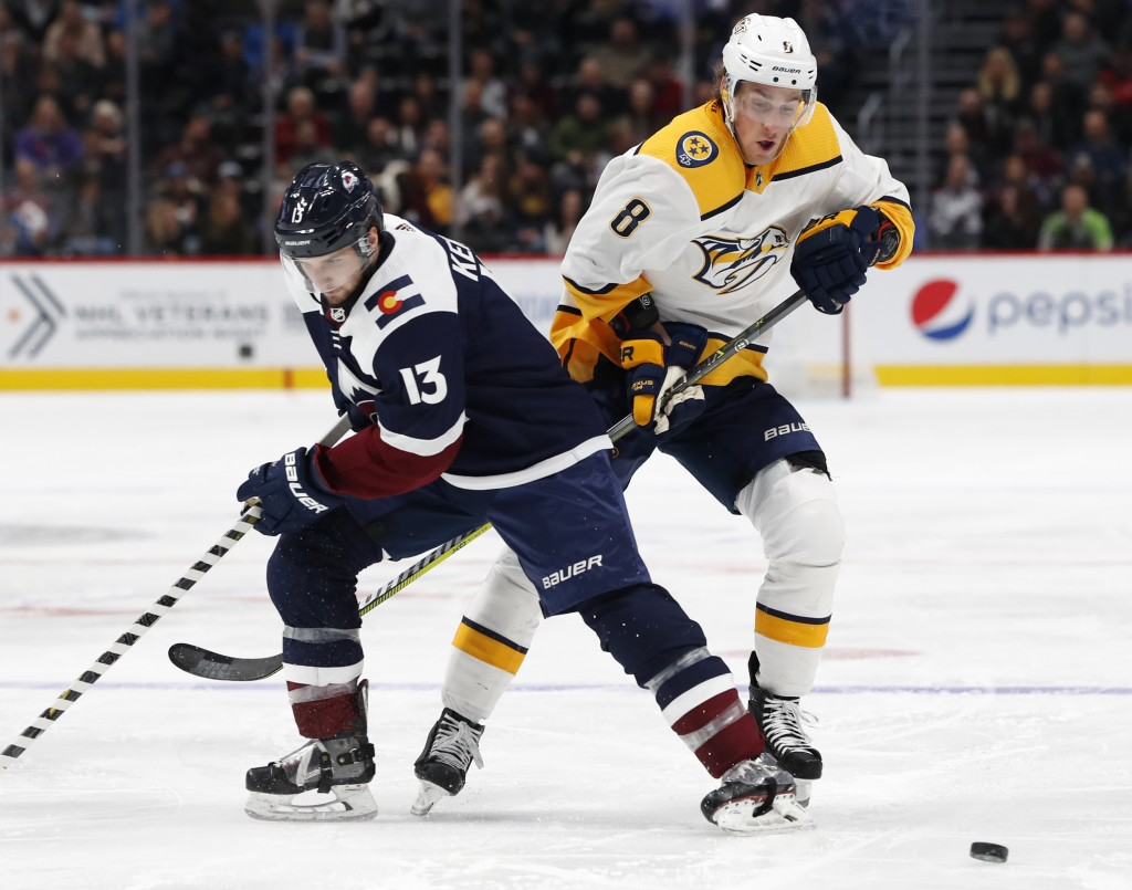 Colorado Avalanche center Alexander Kerfoot, left, and Nashville Predators center Kyle Turris vie for the puck during the second period of an NHL hock