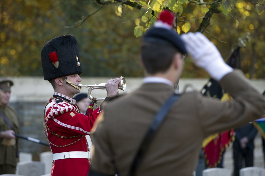 A bugler plays the last post during a reburial ceremony for an unknown British World War I soldier at Buttes New British cemetery in Zonnebeke, Belgiu