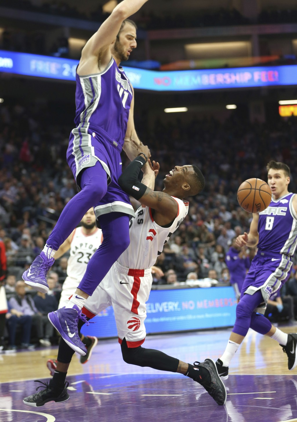 Toronto Raptors guard Delon Wright, right, is fouled by Sacramento Kings center Kosta Koufos, left, during the first quarter of an NBA basketball game