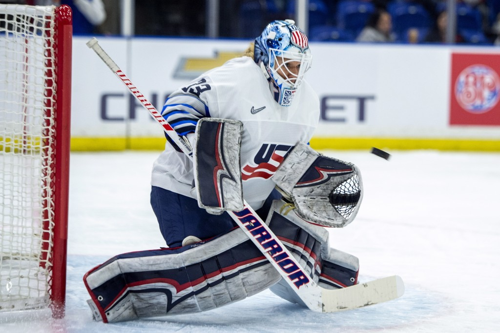 U.S. goaltender Alex Rigsby stops a shot from Canada during the second period of a Four Nations Cup hockey preliminary game in Saskatoon, Saskatchewan