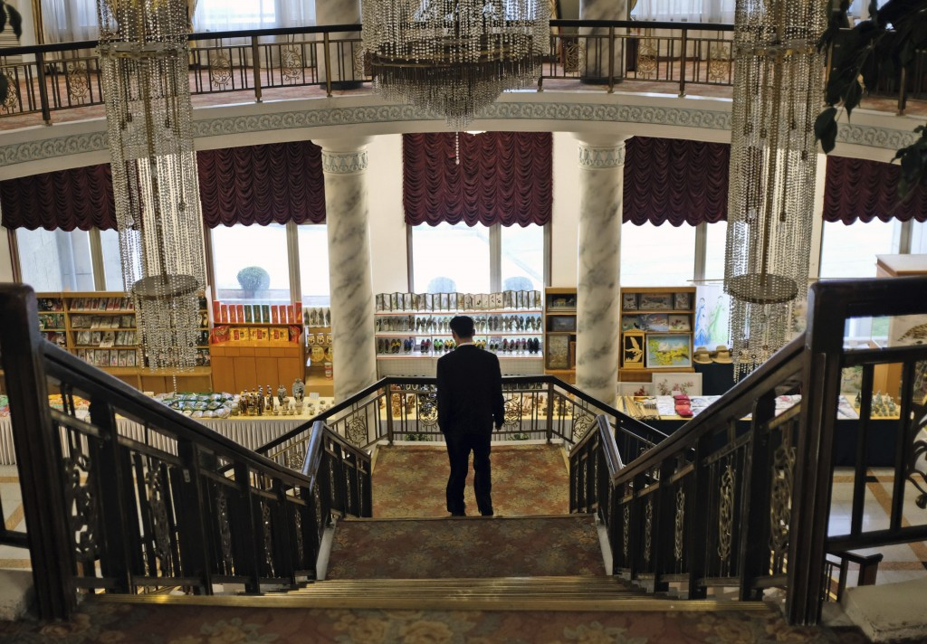 In this Oct. 23, 2018, photo, a man walks down the stairs in the foyer of the Kumgangsan Hotel in front of the hotel's souvenir shop at the Mount Kumg