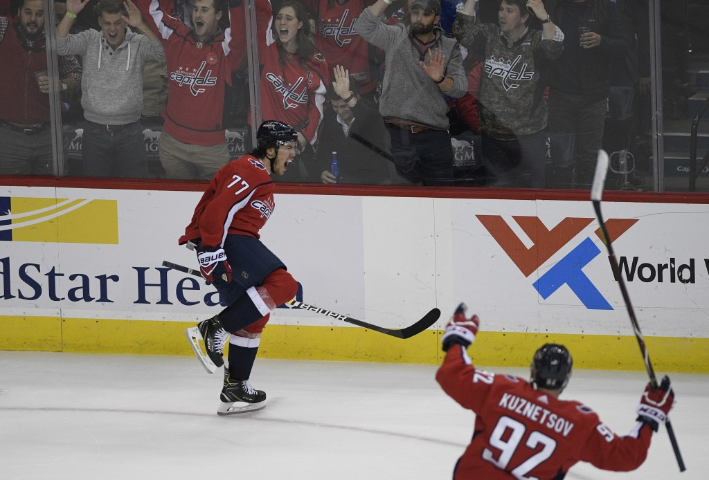 Washington Capitals right wing T.J. Oshie (77) celebrates his goal alongside center Evgeny Kuznetsov (92), of Russia, during the third period of an NH...