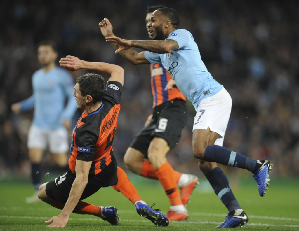 Manchester City midfielder Raheem Sterling, right, scores his side's third goal during the Champions League Group F soccer match between Manchester Ci