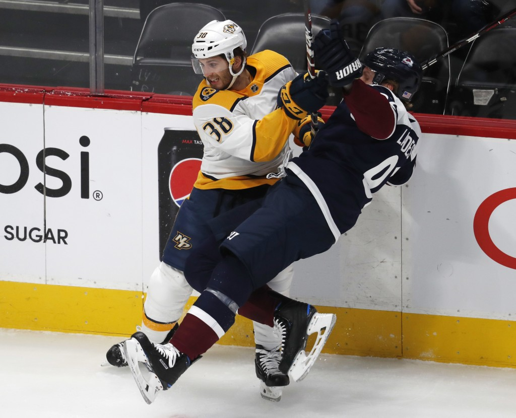 Nashville Predators right wing Ryan Hartman, left, checks Colorado Avalanche left wing Gabriel Landeskog in the first period of an NHL hockey game Wed