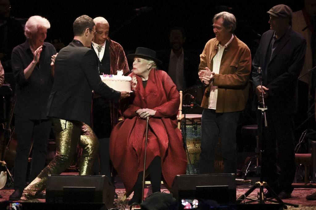 Joni Mitchell is presented with a birthday cake on stage at JONI 75: A Birthday Celebration on Wednesday, Nov. 7, 2018, at the Dorothy Chandler Pavili