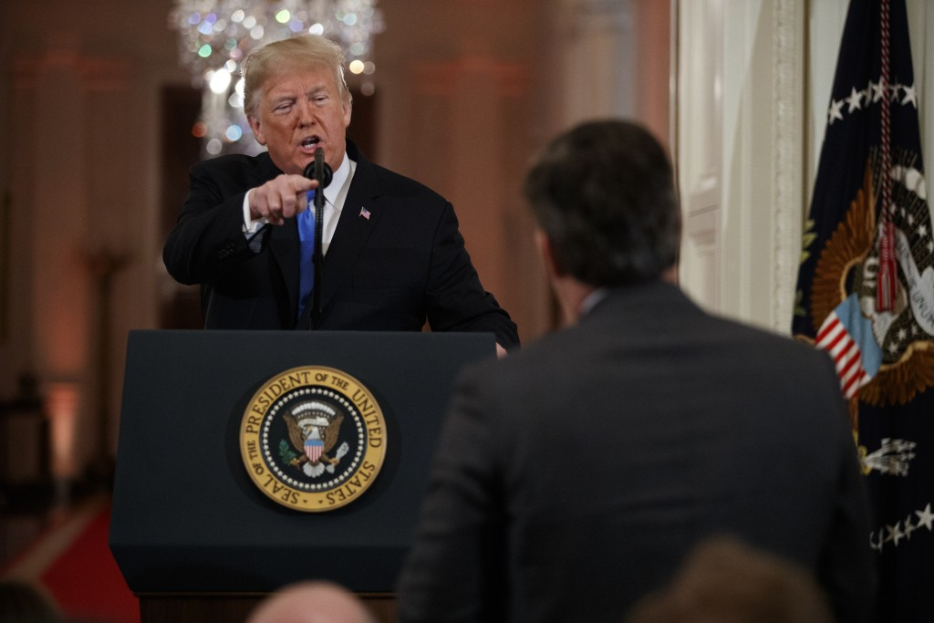President Donald Trump speaks to CNN journalist Jim Acosta during a news conference in the East Room of the White House, Wednesday, Nov. 7, 2018, in W...
