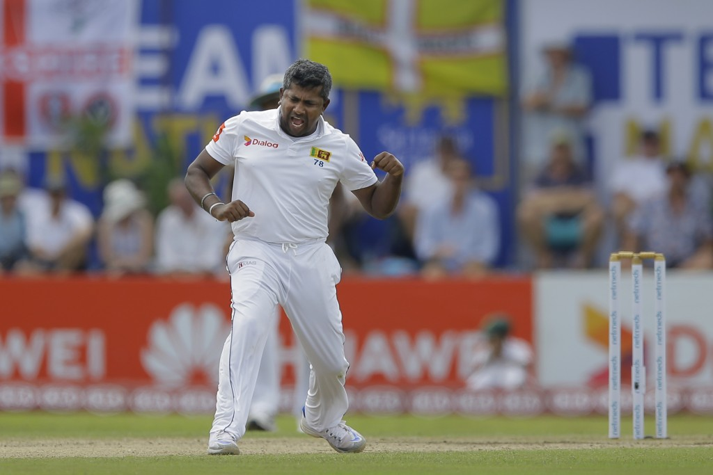 Sri Lanka's Rangana Herath celebrates taking the wicket of England's Joe Root during the third day of the first test cricket match between Sri Lanka a...