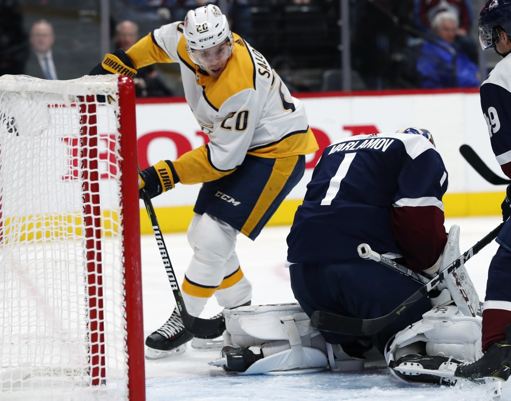 Nashville Predators right wing Miikka Salomaki, left, has his shot stopped by Colorado Avalanche goaltender Semyon Varlamov during the second period o