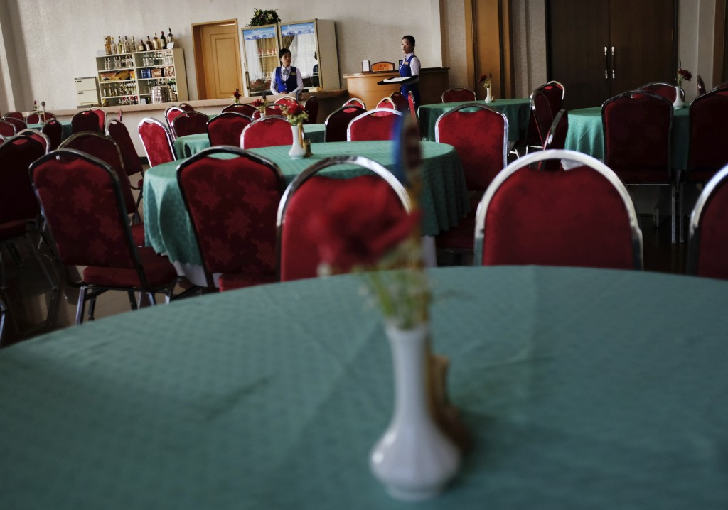 In this Oct. 24, 2018 photo, hotel staff wait for guests during breakfast inside an empty restaurant at the Kumgangsan Hotel in Mount Kumgang North Ko