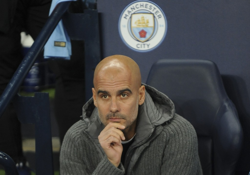 Manchester City coach Pep Guardiola looks on before the Champions League Group F soccer match between Manchester City and Shakhtar Donetsk at Etihad s