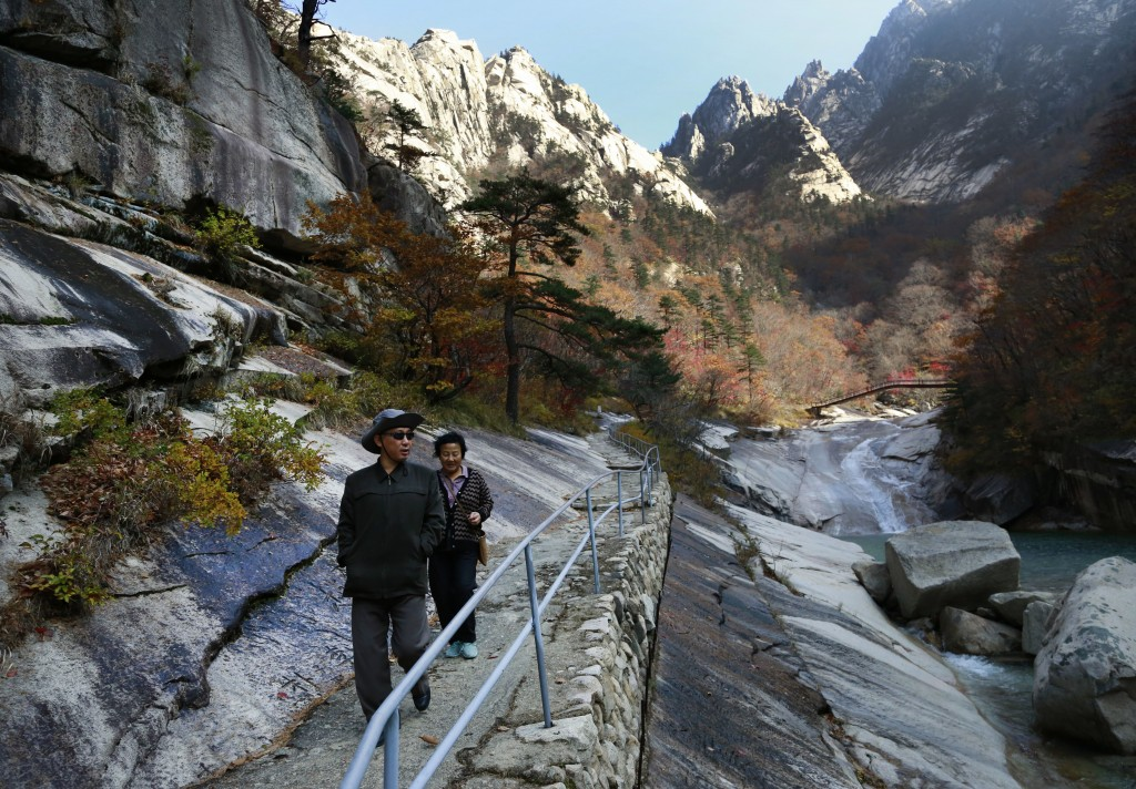 In this Oct. 23, 2018, photo, local tourists walk on the trail at Mount Kumgang, North Korea. At the height of South Korea's policy of engagement with