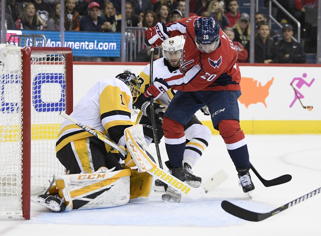 Washington Capitals center Lars Eller (20), of Denmark tires to get the pack past Pittsburgh Penguins goaltender Casey DeSmith (1) and defenseman Kris