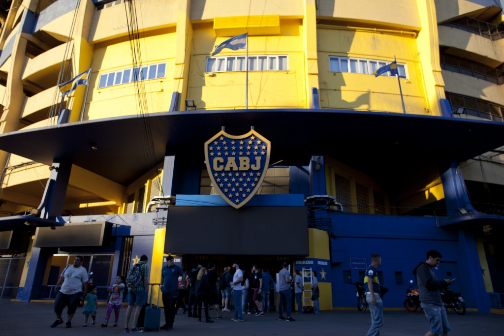 People stand outside Boca Juniors stadium in Buenos Aires, Argentina Wednesday, Nov. 7, 2018. Boca Juniors will face Play River Plate for the Copa Lib