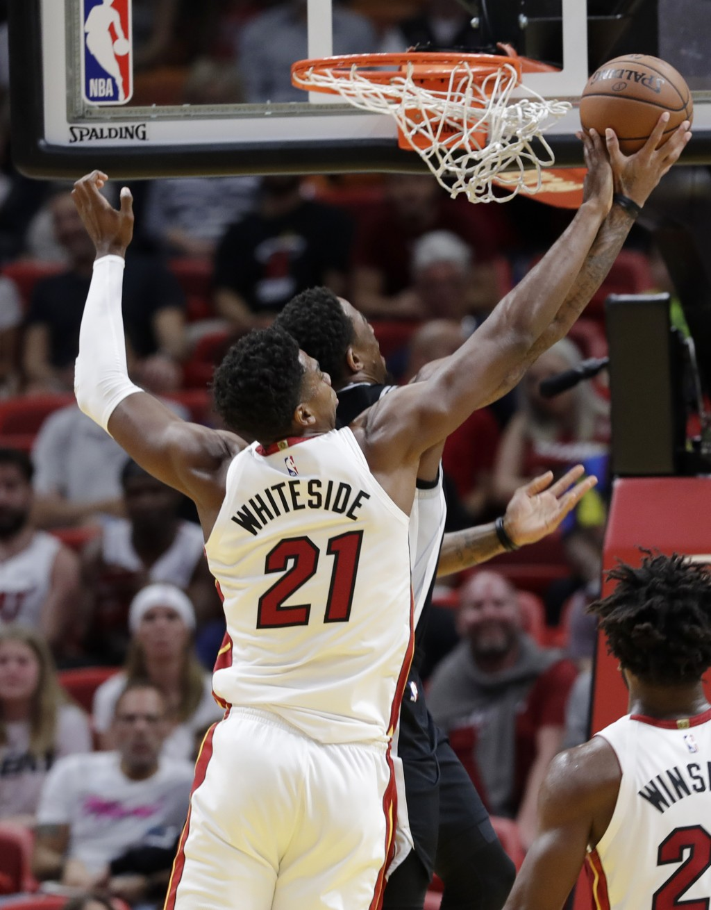 Miami Heat center Hassan Whiteside (21) blocks a shot by San Antonio Spurs guard DeMar DeRozan during the first half of an NBA basketball game, Wednes