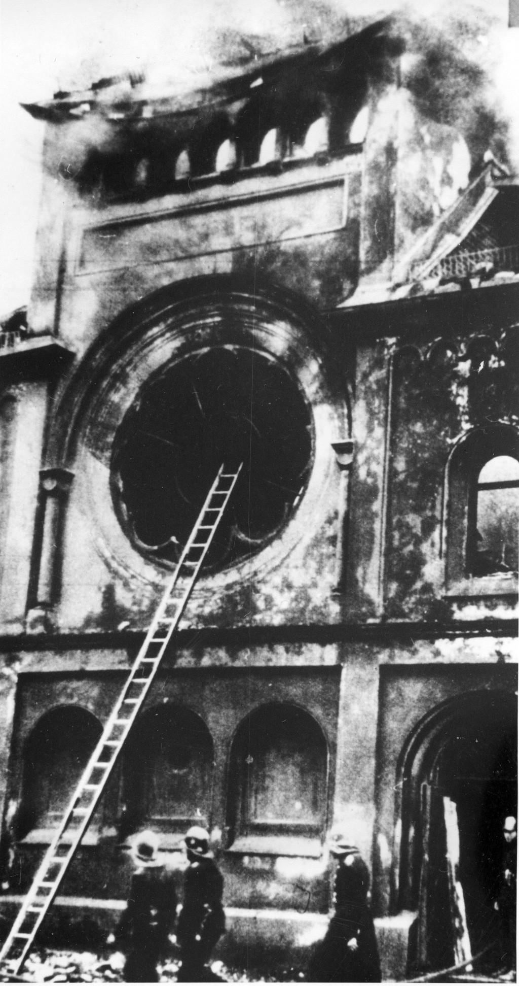 FILE - In this Nov. 10, 1938 file photo firefighters are at the Fasanenstrasse synagogue, Berlin's biggest house of Jewish worship, after Nazis set fi