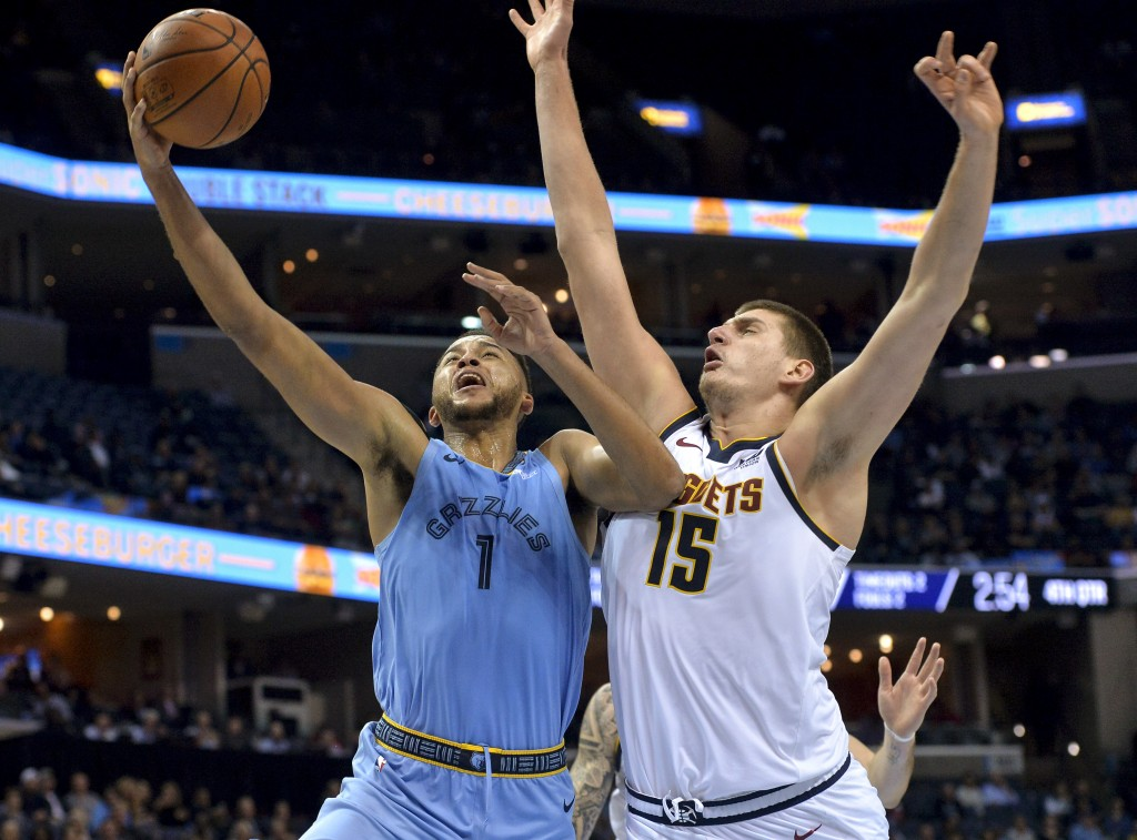 Memphis Grizzlies forward Kyle Anderson (1) shoots against Denver Nuggets center Nikola Jokic (15) in the second half of an NBA basketball game Wednes...