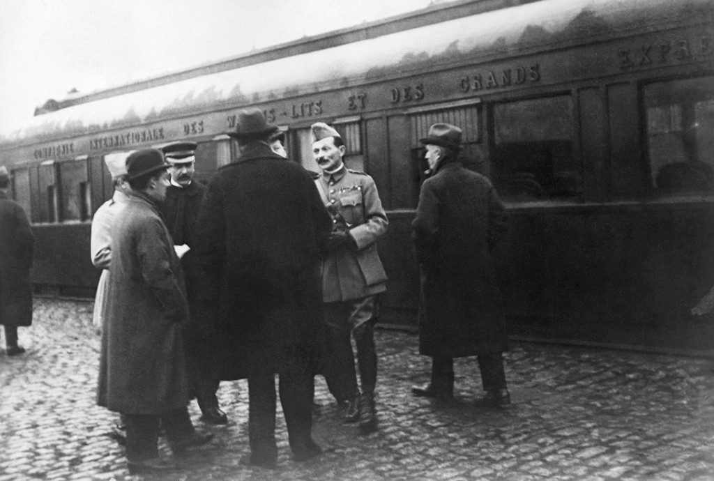FILE - In this file photo from Nov. 1918, the German and French delegations speak as they wait in Rethondes for the start of the train to the Armistic...
